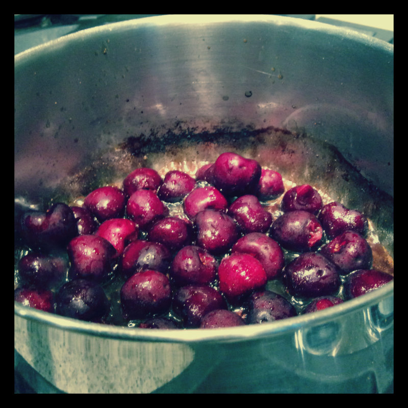 Bringing the cherries to a boil (brandied cherries recipe).